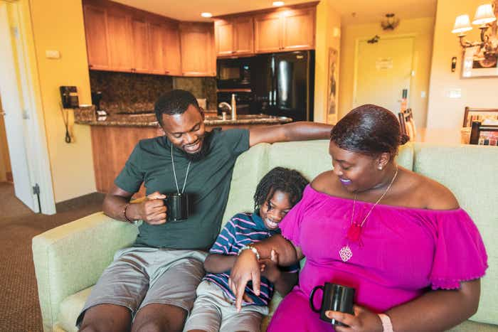 Karen Akpan (right) enjoying coffee at our in their Lake Tahoe Resort villa with her husband (left) and son (middle).