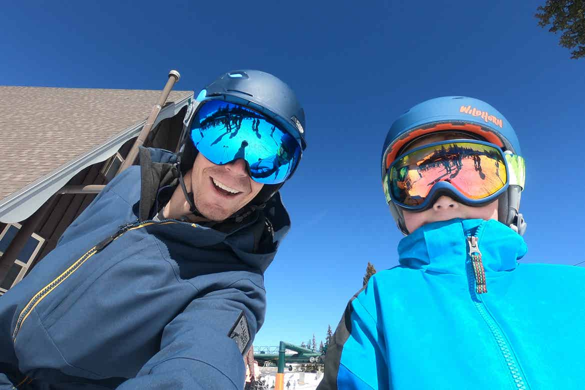 Featured Contributor, Jessica Averett's husband and son wearing protective ski goggles.