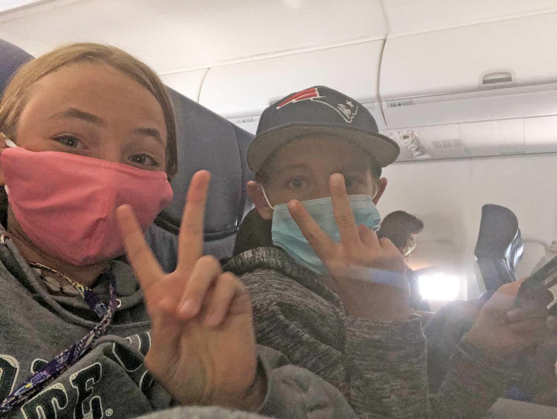 Ashley's kids taking a selfie on the plane
