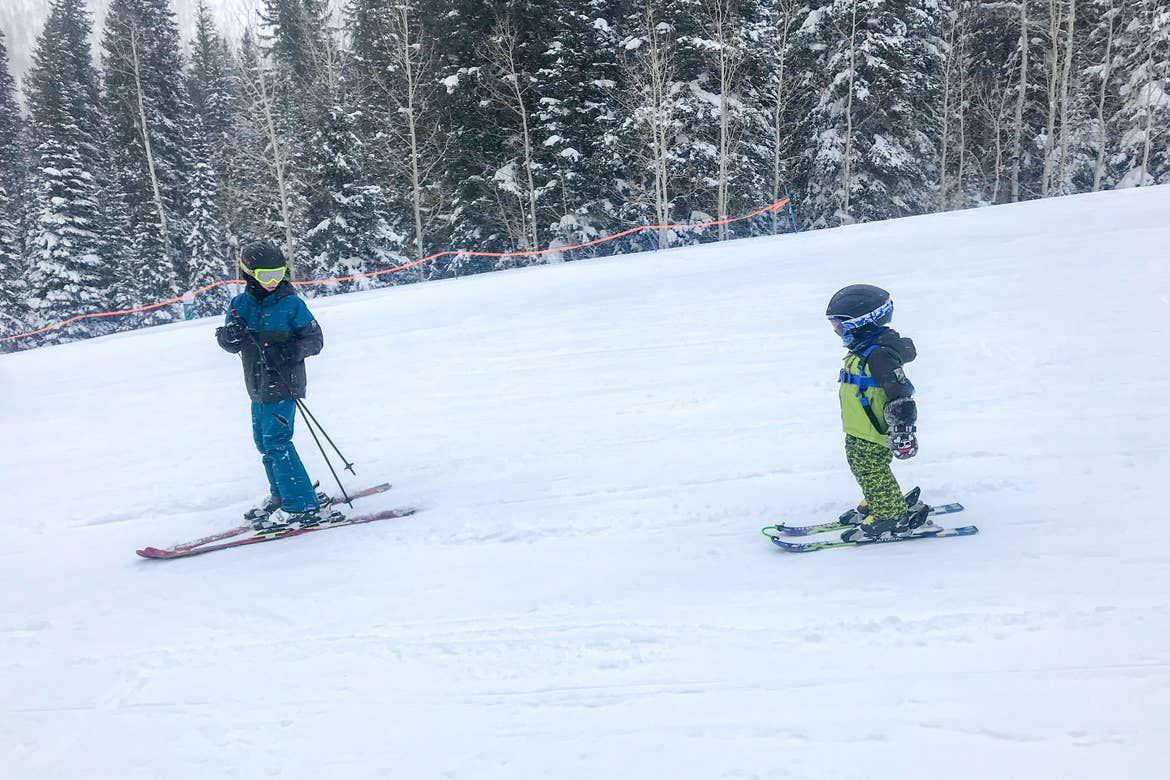 Jessica's sons learn the fundamentals in ski school on the bunny slopes.