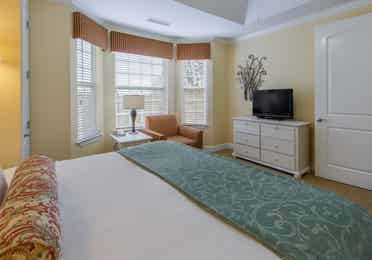 Bedroom in a two-bedroom presidential villa with a view of the window at Apple Mountain Resort in Clarkesville, GA