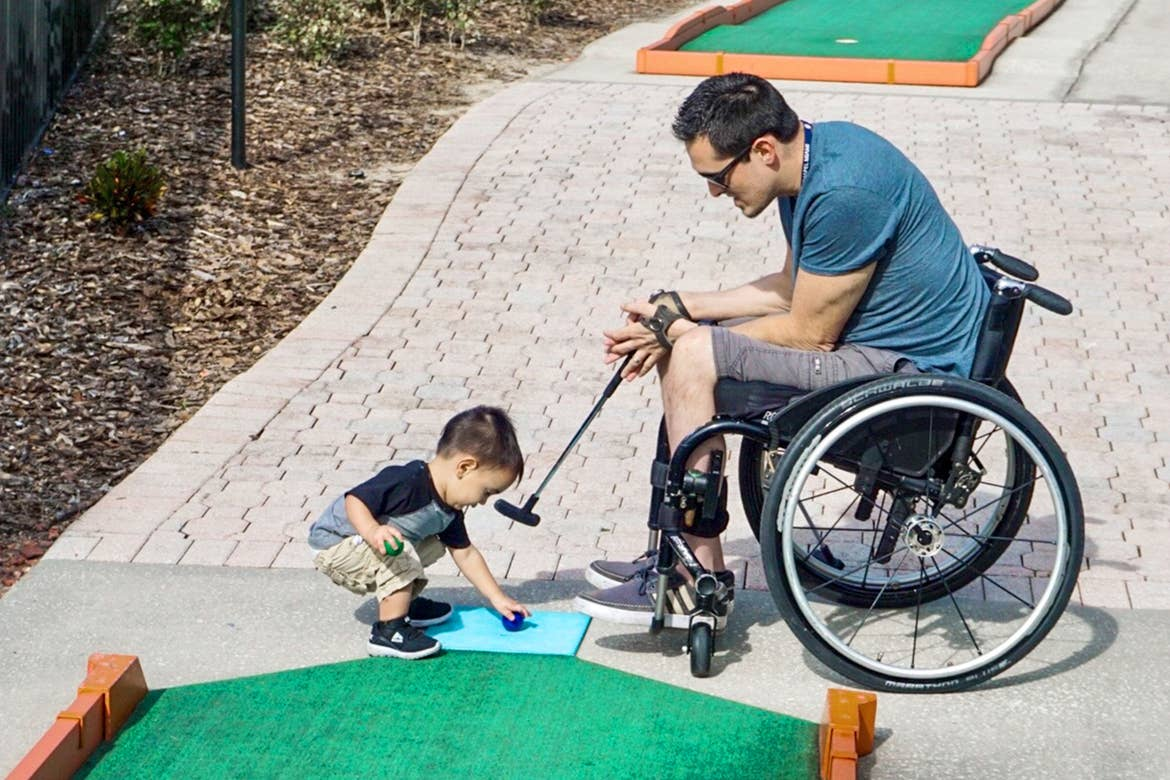 Author, Danny Pitaluga (right), and son, Joey (left), tee up at the mini-golf course located at our Orange Lake Resort located in Orlando, Florida.