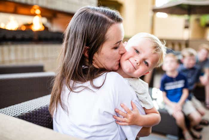 Author, Jessica Averett (left), holds her youngest son on the patio of our Scottsdale Resort.