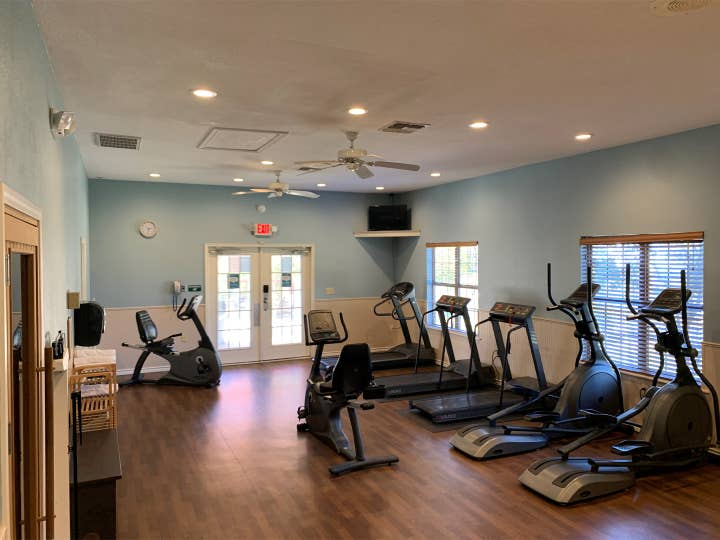 Fitness center at Villages Resort with treadmills, ellipticals and stationary bikes.