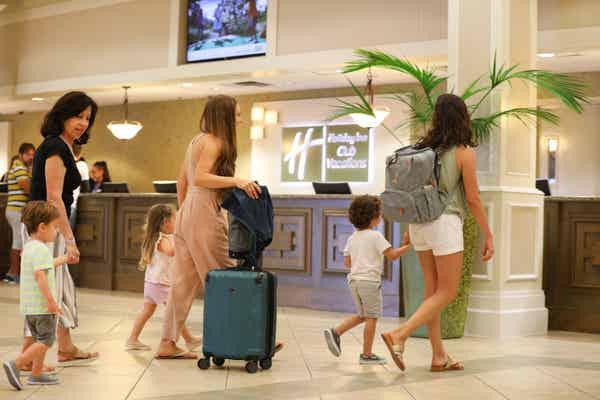 Family walking through the lobby of Orange Lake Resort in Orlando, FL