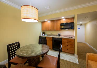Kitchenette and small dining area in a studio room in West Village at Orange Lake Resort near Orlando, FL