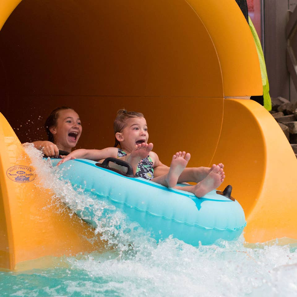 Two young girls on an inner tube coming out of a water slide at Orange Lake Resort in Orlando, FL