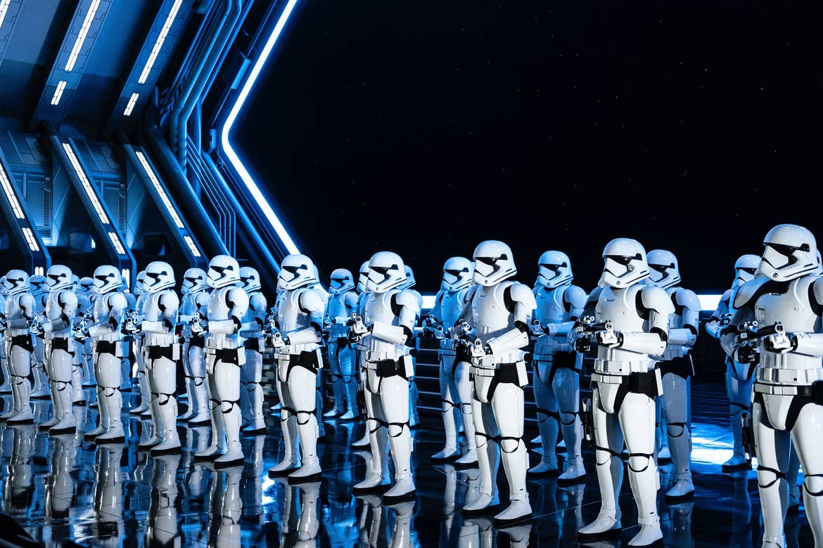 Two rows of First Order Stormtroopers greet guests with blasters in hand at Star Wars: Rise of the Resistance in Disney's Hollywood Studios at Walt Disney World Resort.