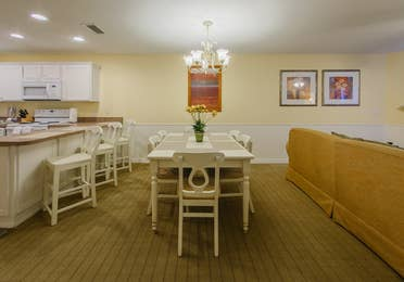 Dining room table with six chairs in a one-bedroom Presidential villa at Hill Country Resort in Canyon Lake, Texas