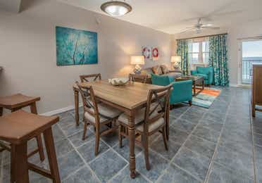 Dining room and table in a one-bedroom villa at Panama City Beach Resort