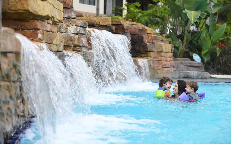Adult and two children enjoying lazy river at Orange Lake Resort.