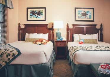 Bedroom with two beds in a villa in North Village at Orange Lake Resort near Orlando, Florida