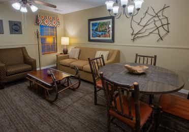 Living room and dining area in a two-bedroom villa at Timber Creek Resort