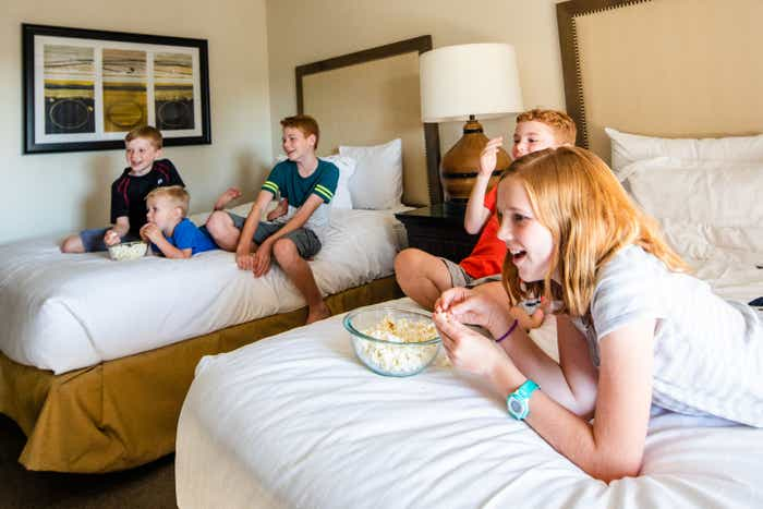 The Averett family enjoys downtime on two beds in our villa at Scottsdale Resort.