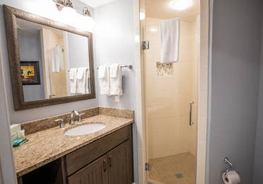 Bathroom with vanity and shower in a two-bedroom villa at Cape Canaveral Beach Resort.