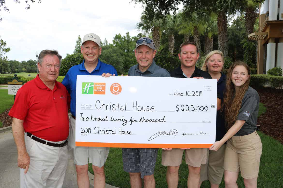 HICV President, Tom Nelson (middle) holds a Charitable Donation Check with representatives of Christel House.