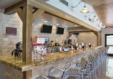 Bar seating in Gold Mine Bar & Grill at Desert Club Resort in Las Vegas, Nevada.