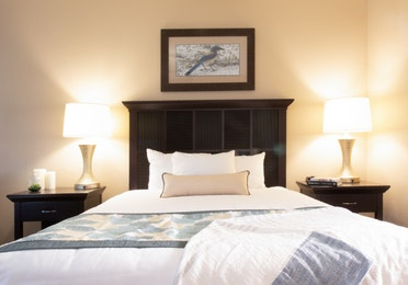 Bed and two nightstands in a three bedroom villa in North Village at Orange Lake Resort near Orlando, Florida
