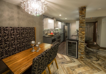 Dining area and kitchen in a two-bedroom Signature Villa at Desert Club Resort in Las Vegas