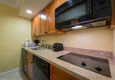 Kitchenette with mini-fridge, microwave, stove top, and sink in West Village at Orange Lake Resort near Orlando, FL