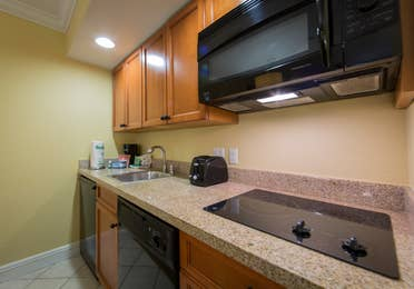 Kitchenette with mini-fridge, microwave, stove top, and sink in West Village at Orange Lake Resort near Orlando, FL