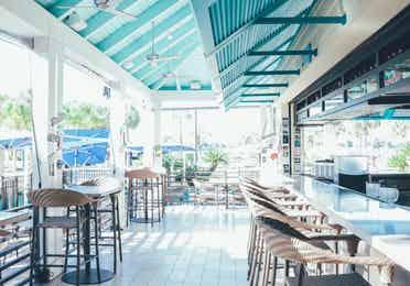 Breezes Restaurant & Bar seating area in West Village at Orange Lake Resort near Orlando, Florida