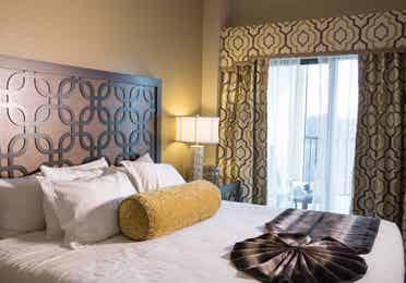 Closeup of bed and large window in a Signature villa in River Island at Orange Lake Resort near Orlando, Florida