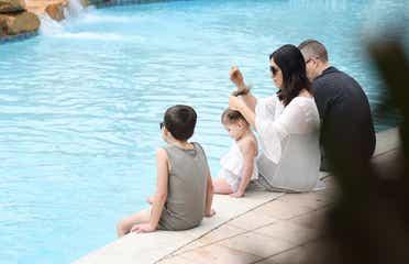 Family sitting near the pool at Orange Lake Resort in Orlando, FL