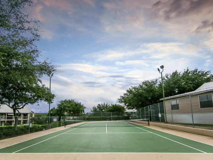 Outdoor tennis court at Hill Country Resort in Canyon Lake, Texas.