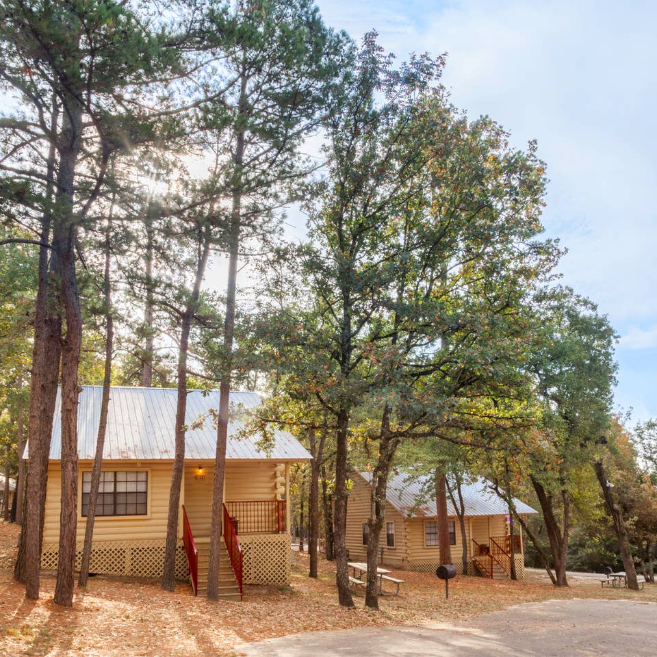 Property building surrounded by trees at Holly Lake Resort in Texas.