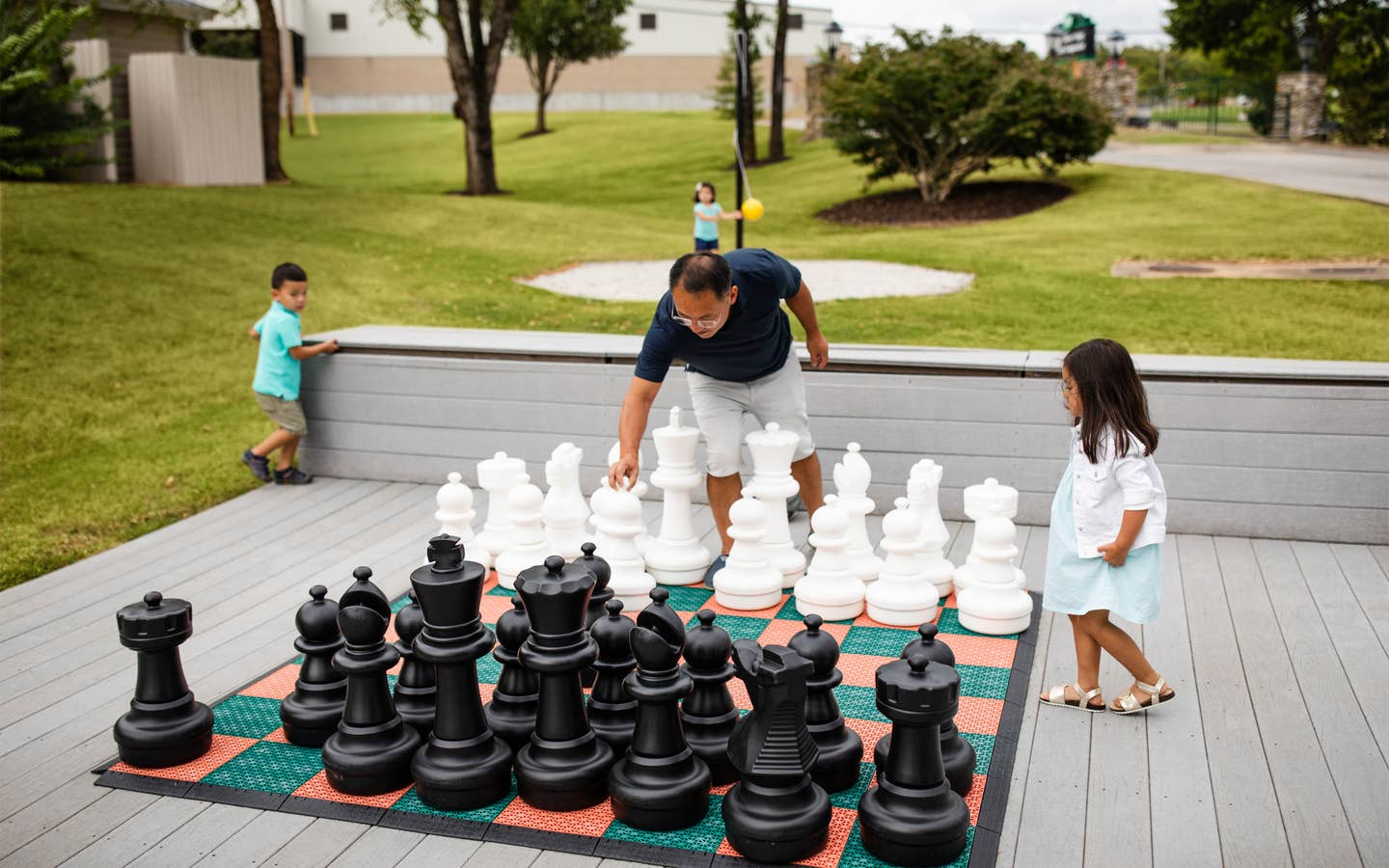 Family playing life-sized chess at Holiday Hills Resort in Branson, Missouri.