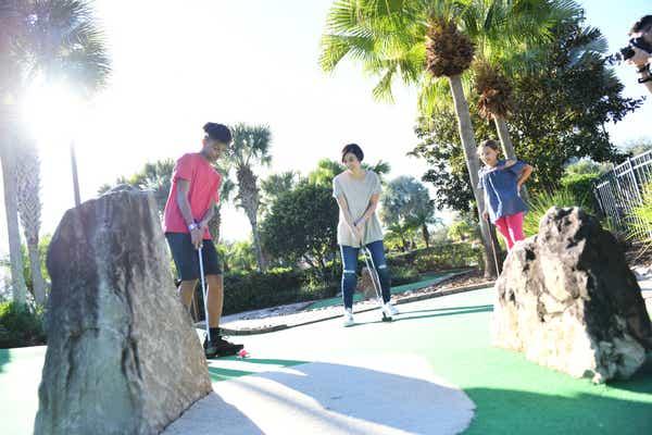 Family enjoying mini golf at Orange Lake Resort near Orlando, Florida