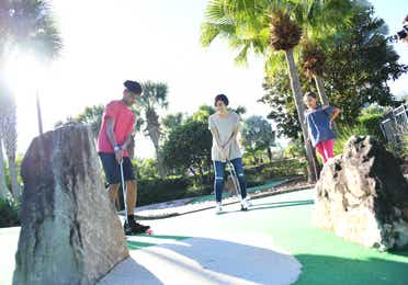 Family enjoying mini golf at Orange Lake Resort near Orlando, Florida