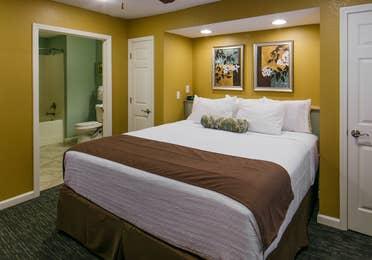 Bed in a villa at Orlando Breeze Resort in Florida.