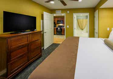 Master bedroom with a view of TV in a one-bedroom ambassador villa at the Hill Country Resort in Canyon Lake, Texas.