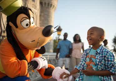 Child at Disney's Magic Kingdom interacting with Goofy near Orange Lake Resort
