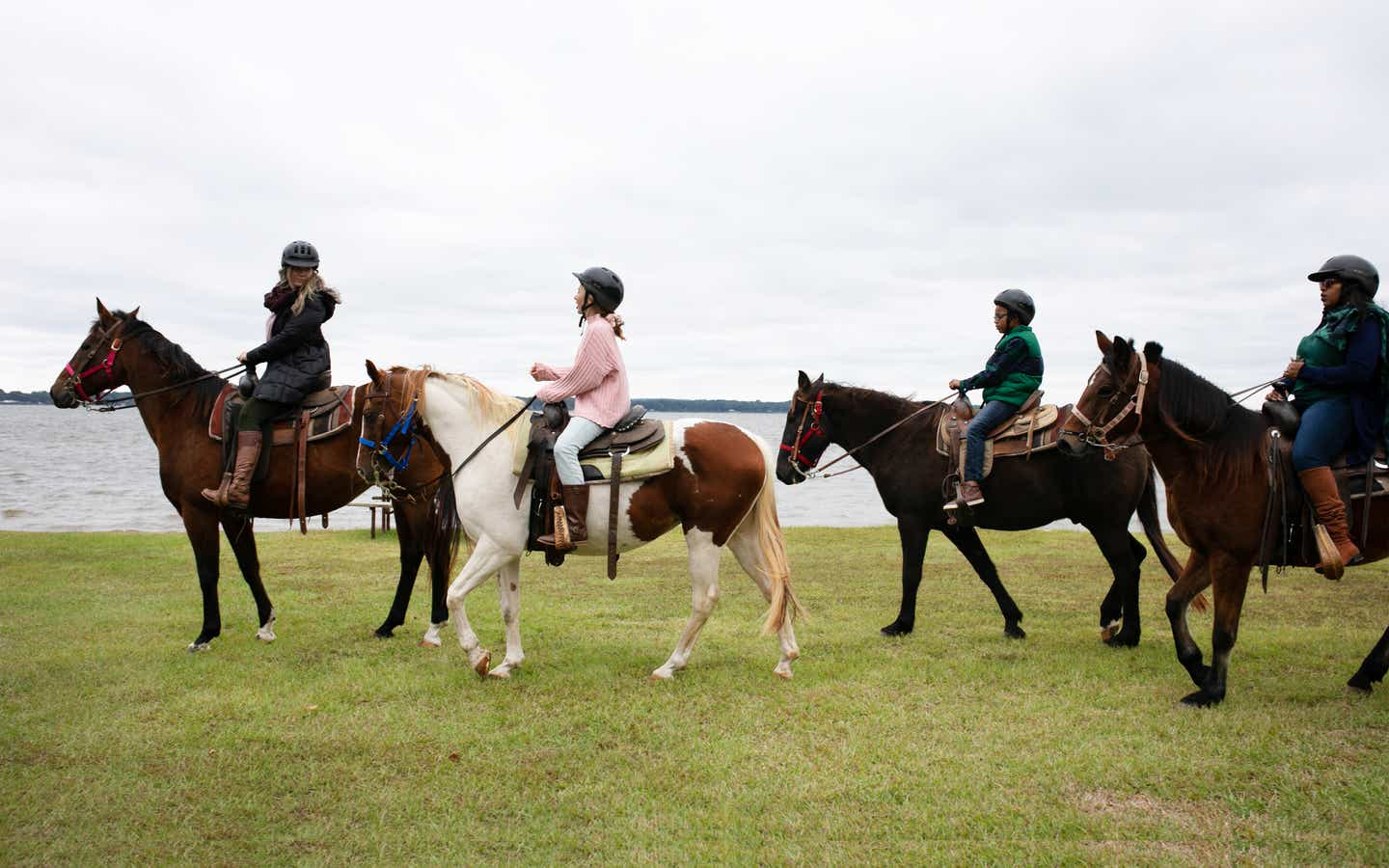 Group of three people riding horses at Villages Resort in Flint, Texas.