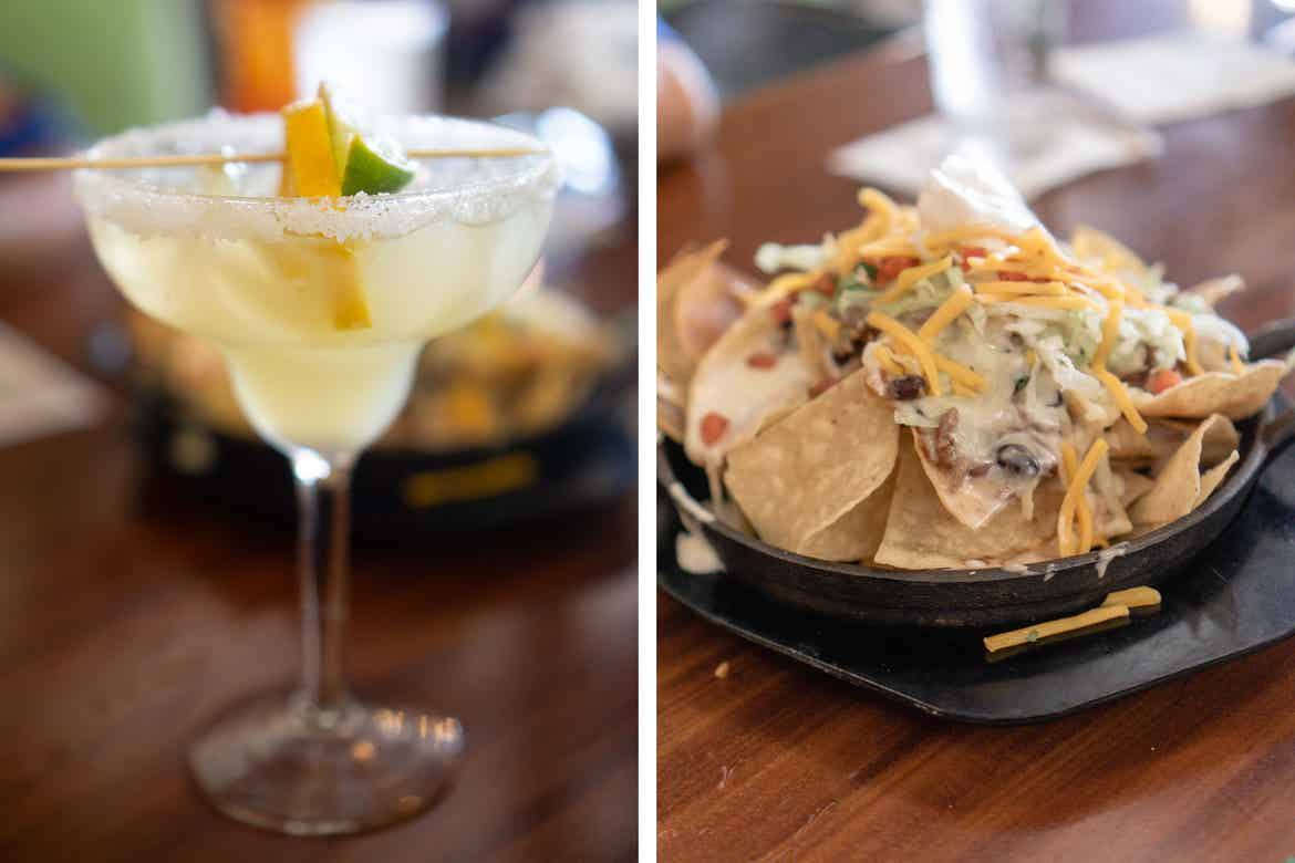 Left: An alcoholic beverage with garnish sits on a tabletop. Right: An appetizer with toppings sits on a tabletop in a black bowl.