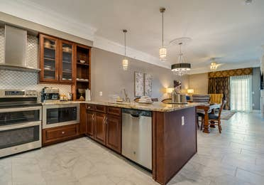 Kitchen with stainless steel appliances in a Signature Collection villa at Williamsburg Resort.