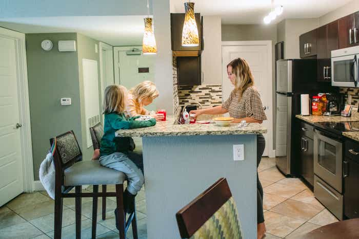 The Haby kids add ice cream toppings in the kitchen of their Signature Collection villa at our Desert Club Resort located in Las Vegas, Nevada.