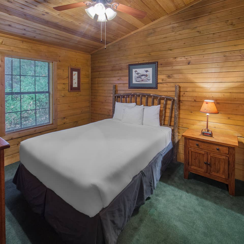 Bedroom in a cabin at Holly Lake Resort in Holly Lake Ranch, Texas.