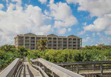 View of property buildings from beach at Cape Canaveral Beach Resort