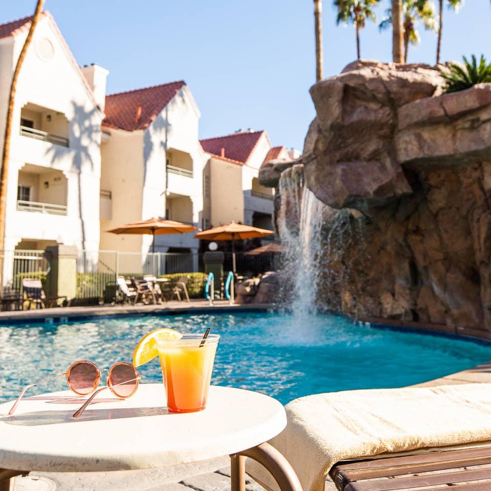 Drinks by waterfall pool at Desert Club Resort in Las Vegas, Nevada.