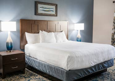 Bedroom with bed and two nightstands in a two-bedroom villa at Cape Canaveral Beach Resort.