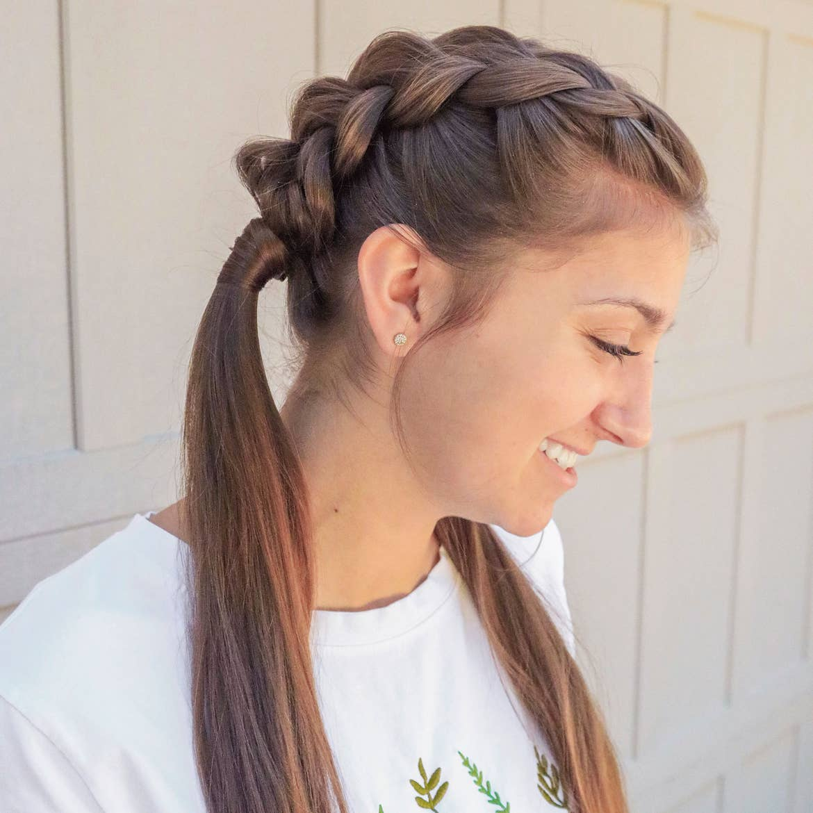 Mindy's daughter, Kamri, sporting the dutch-braid hairstyle from a profile.