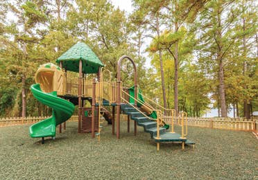 Children's outdoor playground with slides at Lake O' the Wood Resort in Flint Texas.