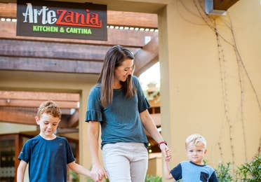 Adult and two young children by ArteZania Kitchen & Cantina at Scottsdale Resort in Scottsdale, Arizona.