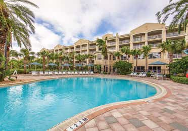 Outdoor pool surrounded by palm trees at Cape Canaveral Beach Resort