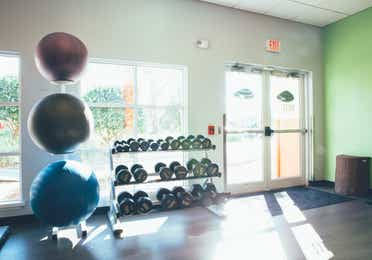 Fitness center with yoga balls and free weights in River Island at Orange Lake Resort near Orlando, Florida