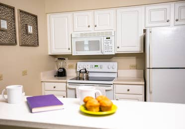 Full kitchen with stove, microwave and fridge in a two-bedroom villa at South Beach Resort in Myrtle Beach, South Carolina.